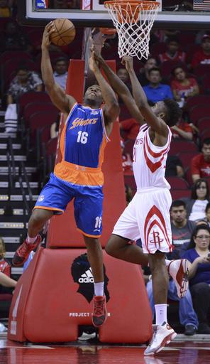 The Shanghai Sharks Guerschon Yabusele (16) shoots against the Houston Rockets Chinanu Onuaku (21) in the second half of an NBA basketball exhibition game Sunday, Oct. 2, 2016, in Houston. (AP Photo/George Bridges)